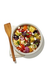 Isolated of rainbow ratatouille served in bowl against white background