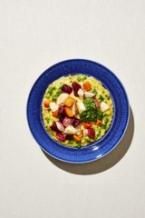 Creamy polenta with roasted vegetables and kale pesto served on plate