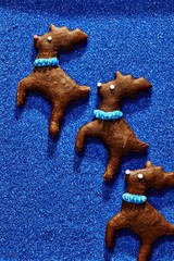 Close up of gingerbread biscuits over blue background