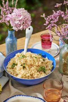 Close up of sweet onion risotto served in bowl on table