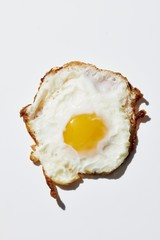 Fried egg isolated against white background