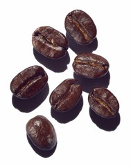 Close up of roasted coffee beans isolated on white background