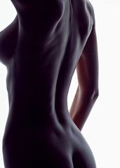 Midsection of naked woman posing against white background