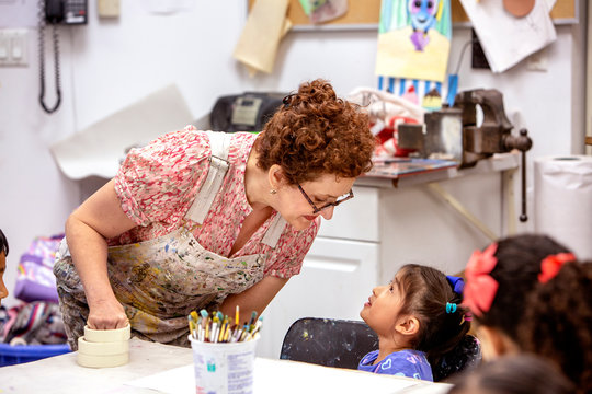 Teacher speaking with a young student