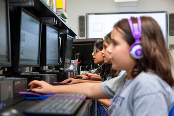 Children using computer in a classroom