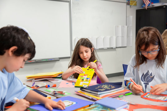 Children writing in a classroom