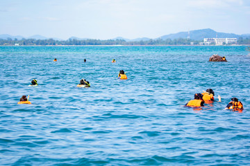 Travelers are diving to see the coral reefs happily. During the high season in Koh Samet, The Gulf of Thai, Rayong Province, campaign for tourism in Thailand.