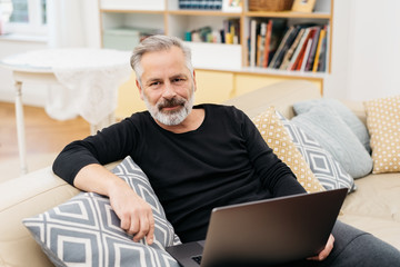 Attractive grey haired bearded man relaxing