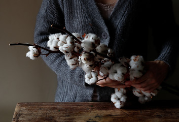 Woman with cotton twigs