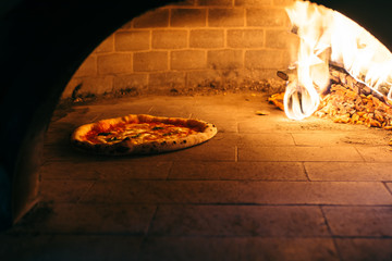 Traditional style of a pizza oven with a pizza
