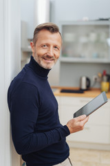 Smiling man with tablet pc, looking at camera