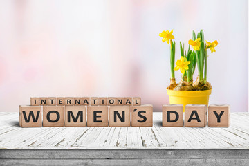 International Womens day sign with a yellow daffodil flower