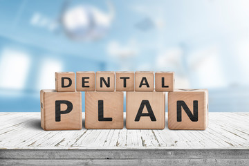 Dental plan sign with a blue room in the background
