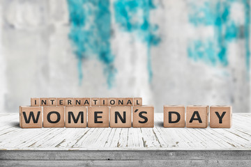 International Womens day sign on a wooden table