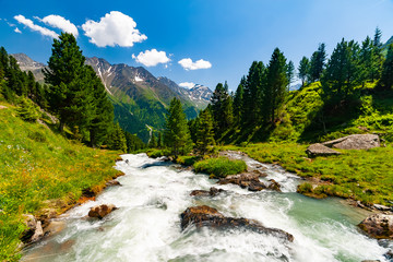 Beautiful summer landscape of mountains and fresh water in river, Tyrol Alps, Austria
