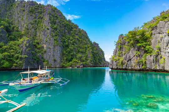 CORON / PHILIPPINES - OCTOBER 31, 2018: Traditional outrigger tourist boats at the landing station for Kayangan Lake. Travel vacation at Philippines.