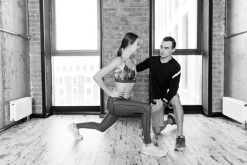 body care with a personal trainer. black and white photo.correction. fitnesss program. help.