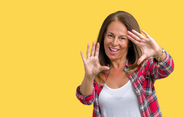 Beautiful middle age woman wearing over isolated background Smiling doing frame using hands palms and fingers, camera perspective