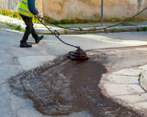 bituminous emulsion sprayed on the surface before starting the laying of the asphalt for road repair