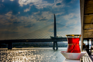 The turkish tea with the bridge in  background