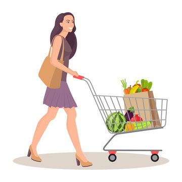 Beautiful young woman with shopping cart full of packages with vegetables and fruits. Happy smiling woman with products. Vector illustration in flat style, isolated on white.