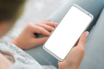 phone white screen woman's hands smartphone. Mockup image of smart phone. close up. chroma key. holding mobile