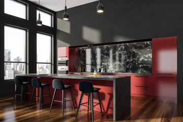 Gray and red kitchen corner with bar