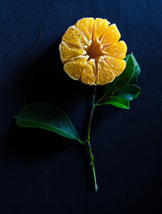 Overhead view of orange slices in flower shape on table