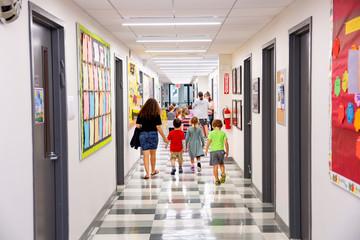 Children walking down school hallway