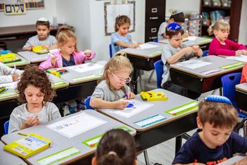 Students drawing at desks