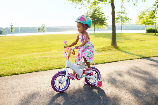Young girl riding a bike in a park