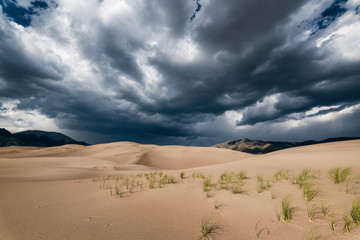 View of desert against stormy clouds at Great Sand Dunes National Park and Preserve Fotoväggar