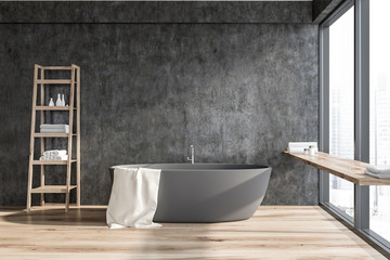 Dark gray bathroom with tub