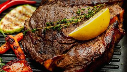 steak on a wooden board, closeup