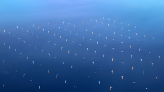 Windmills at the sea. Clean energy made by the wind.
