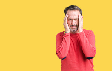 Handsome middle age hoary senior man wearing winter sweater over isolated background with hand on head for pain in head because stress. Suffering migraine.