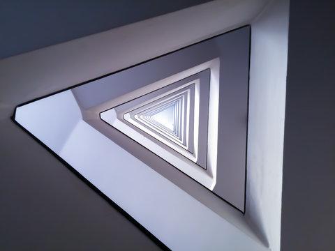 Purple triangle infinite spiral pattern minimal modern staircase architecture abstract spiritual symbol