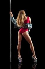 Poledancer on black background