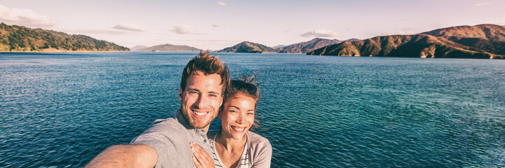 Wall Mural - Cruise ship holiday travel vacation tourists taking selfie on summer holidays destination banner panorama .Interracial couple Asian woman tourist, Caucasian man smiling.