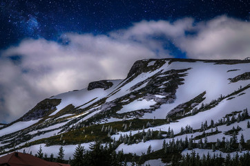 Wall Mural - Winter mountains panorama with snowy peaks at night in Ukrainian Carpathians.