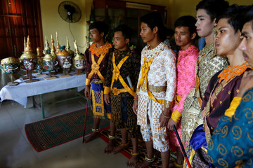 Dancers get ready before a performance of masked theatre known as Lakhon Khol in Kandal province