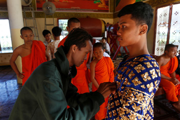 Dancer gets ready before a performance of masked theatre known as Lakhon Khol in Kandal province