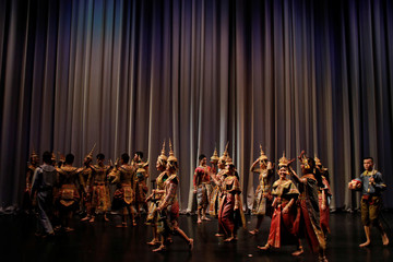 Dancers walk behind the curtain on stage after a performance of masked theatre known as Khon at the Thailand Cultural Centre in Bangkok