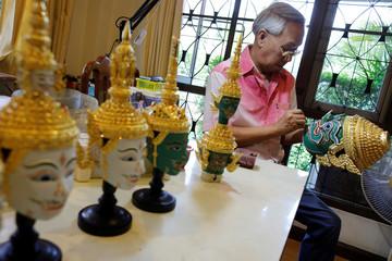 Mom Luang Pongsawad Sukhasvasti works at his theatre mask studio in Ayutthaya province