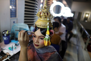 Dancers get ready backstage before a performance of masked theatre known as Khon at the Thailand Cultural Centre in Bangkok