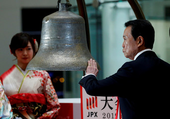 Japan's Deputy Prime Minister and Finance Minister Taro Aso prepares to ring a bell during the New Year opening ceremony at the Tokyo Stock Exchange (TSE), held to wish for the success of Japan's stock market, in Tokyo