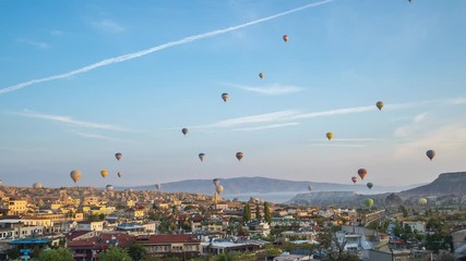 Wall Mural - Cappadocia city skyline with balloon flying inTurkey, timelapse 4K