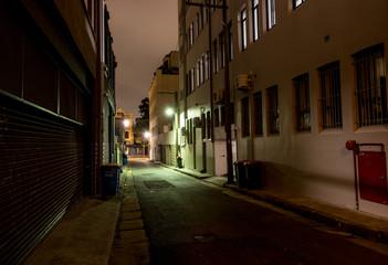 dark alley at night under cloud