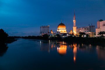 Klang city waterfront during blue hour with reflection in the river