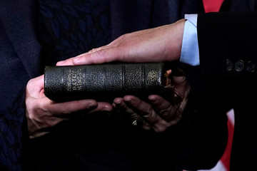 Rep. TJ Cox (D-CA) poses with a Bible for a ceremonial swearing-in picture on Capitol Hill in Washington